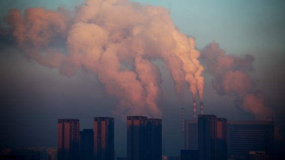 This picture taken on January 22, 2013 shows a thermal power plant discharging heavy smog into the air in Changchun, northeast China