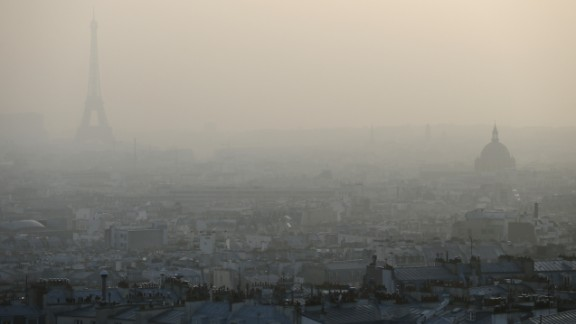 Photo taken on March 11, 2014 shows the Eiffel tower and Paris' roofs through a haze of pollution. French non-governmental organization (NGO) Ecologie Sans Frontiere (Ecology without borders) confirmed on March 11 that they had filed a criminal complaint in Paris to denounce the 'health scandal' of air pollution, as several regions of France experienced high levels of particulate pollution. AFP PHOTO / PATRICK KOVARIK (Photo credit should read PATRICK KOVARIK/AFP/Getty Images)