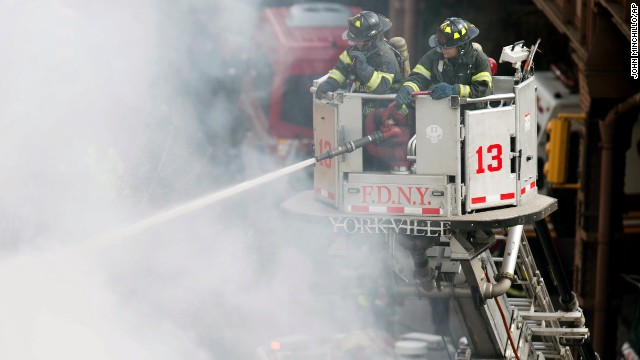 Firefighters respond to the fire on in Harlem.