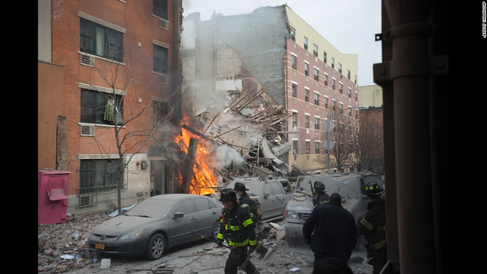 New York firefighters battle the fire near 116th Street and Park Avenue, once the heart of the city's large Puerto Rican community.