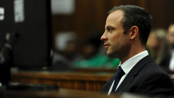 Oscar Pistorius sits in the dock as he listens to cross questioning about the events surrounding the shooting death of his girlfriend Reeva Steenkamp, in court during the second week of his trial in Pretoria, South Africa, Wedensday, March 12, 2014.