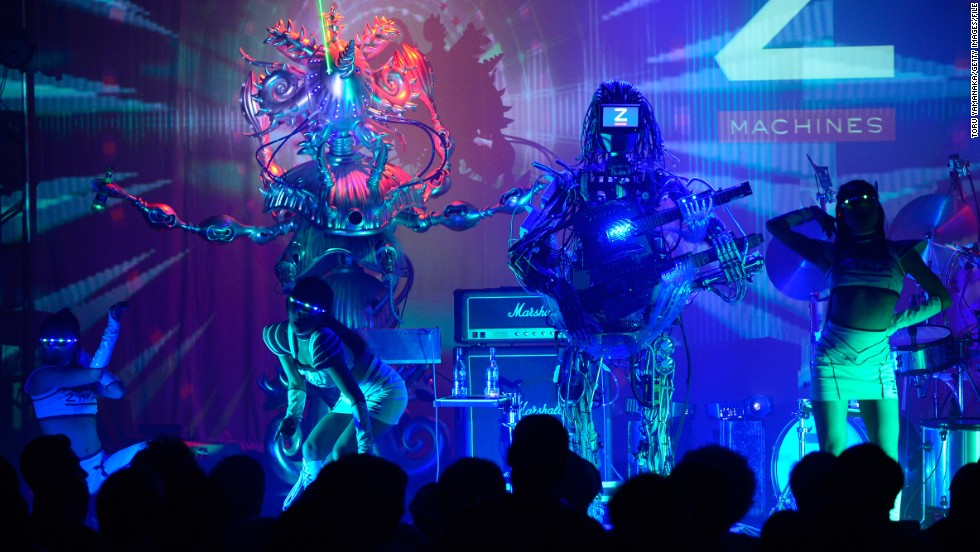 The band, created by engineers from the University of Tokyo, include a guitarist with 78 fingers, a drummer with 22 arms, and a keyboardist which shoots green lasers.