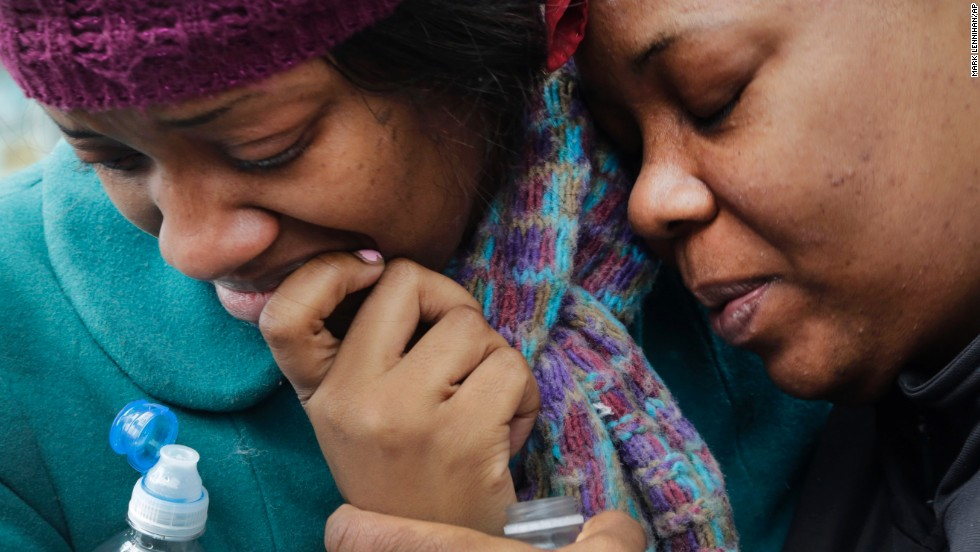 Alecia Thomas, left, is comforted by her friend, Shivon Dollar, after Thomas' home was destroyed in the explosion.