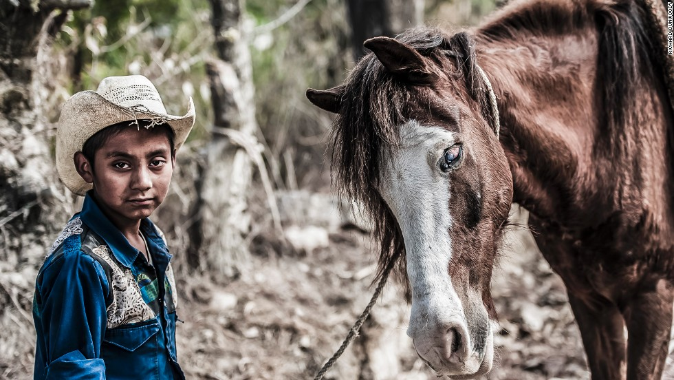 Many of former jockey Richard Dunwoody's pictures have an equine theme, including this of a boy and his blind pony in the countryside near Chimaltenango in Guatemala.