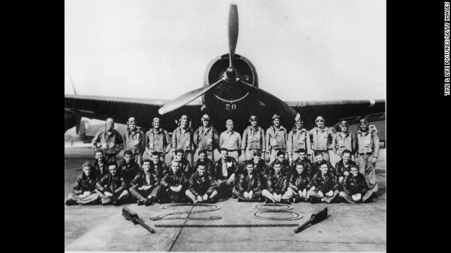 Members of the Navy pose in front of one of the Flight 19 planes that disappeared in 1945.