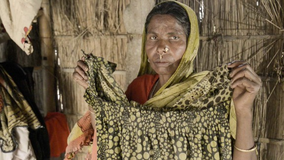 Jaida's mother, Saleha, believes her daughter was kidnapped by a trafficker who sold her into a forced marriage or prostitution. Saleha holds a dress Jaida left behind. The problem of missing women runs rampant in villages in western India.