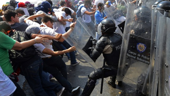 Venezuelan students clash with riot police during a protest against the government on Wednesday, March 12.