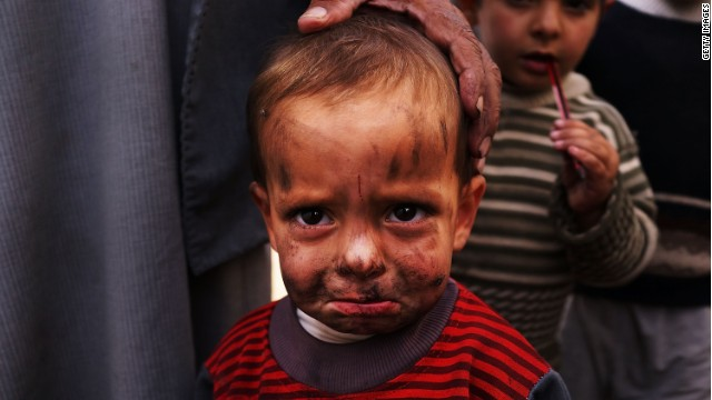 A displaced Syrian child is viewed in a makeshift camp for Syrian refugees only miles from the border with Syria in the Bekaa Valley on November 12, 2013 in Majdal Anjar, Lebanon.