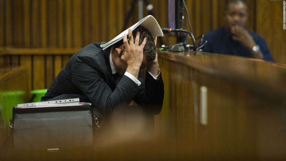Pistorius covers his head as he listens to forensic evidence Thursday, March 13.