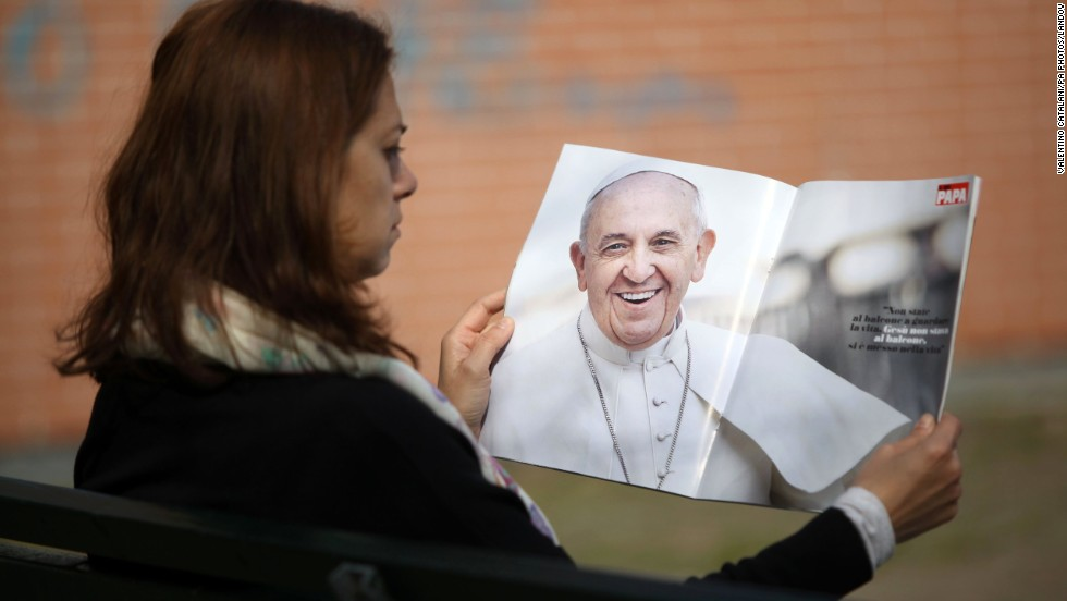 "A woman in Milan, Italy, reads a copy of the magazine ""Il Mio Papa,"" or ""My Pope,"" on Tuesday, March 11. Pope Francis has enjoyed nearly <a href=""http://www.cnn.com/2013/11/09/world/gallery/pope-francis/index.html"">unprecedented popularity since his election</a> last year."