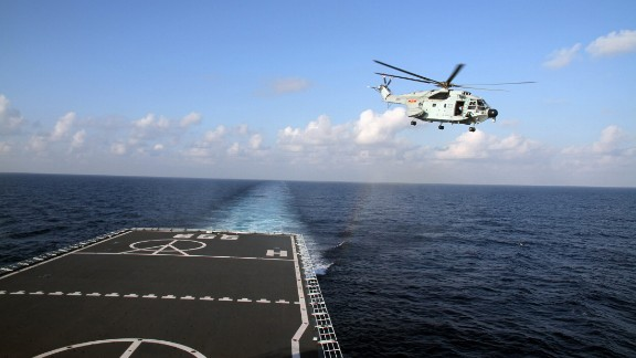 A helicopter takes off from the Chinese naval vessel Jianggangshan to carry out a search operation on Thursday, March 13.