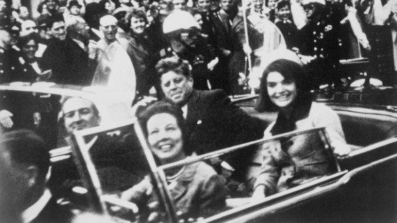 U.S. President John F. Kennedy sits with the first lady in the back of a limousine November 22, 1963, in Dallas. Kennedy's assassination remains one of the most shocking events of the 20th century, and it's also one of its biggest mysteries. While a blue ribbon panel concluded there was only one gunman, a Gallup survey six decades later found that 60% of Americans don't believe that.