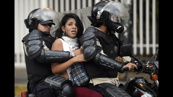 An activist is taken by police during an anti-government protest in Caracas on March 13.