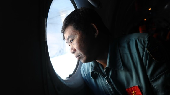A pilot on board a Vietnamese Air Force Russian-made AN-27 searches Vietnam's southern sea for missing Malaysia Airlines' flight MH370 on March 14, 2014.