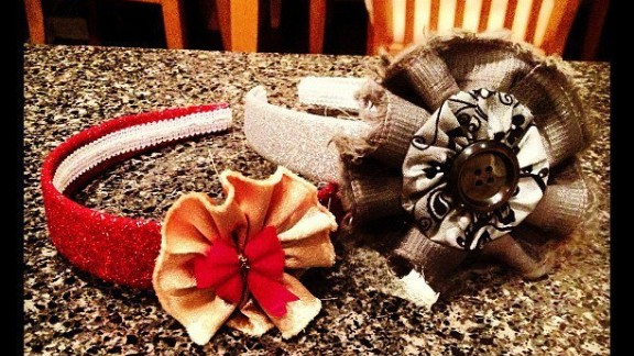 """These headbands were designed by Elyse, using fabric flowers Linzey learned to sew through tutorials on Pinterest. """"No particular occasion, just filling time."""""""