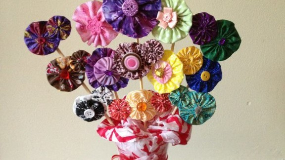 """A fabric-flower hair clip display made as a raffle gift for a fundraiser for <a href=""""http://www.anabelleswish.org"""" target=""""_blank"""" target=""""_blank"""">Anabelle's Wish</a>, a charitable organization in Anabelle's name to assist families who have children with rare neurological disorders."""