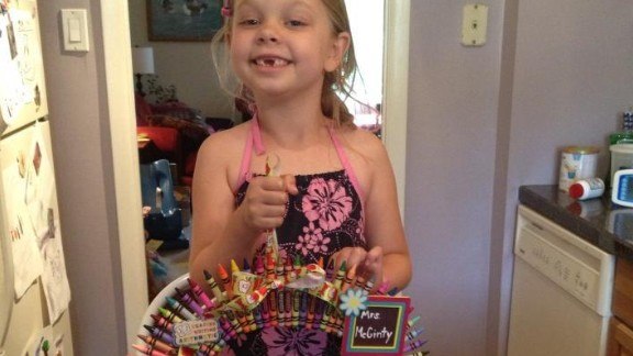 Katherine Linzey's 6-year-old daughter, Elyse, poses with a crayon wreath made as an end-of-year gift for her kindergarten teacher last year.