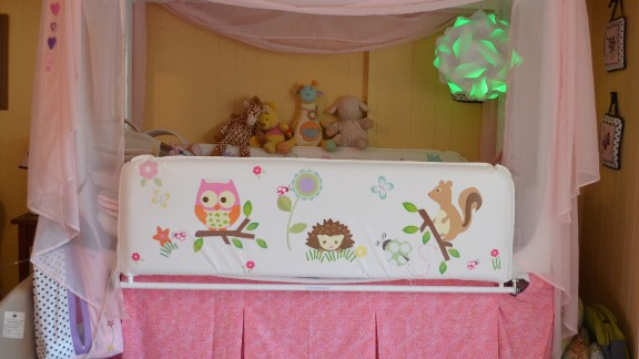 """Anabelle outgrew her crib this year, but still needed something to contain her and prop her in the right sleeping position, so the family got a hospital bed. """"It was so medical-looking and looked out of place in our home, so we dressed it up,"""" Linzey said. Elyse designed the stickers."""