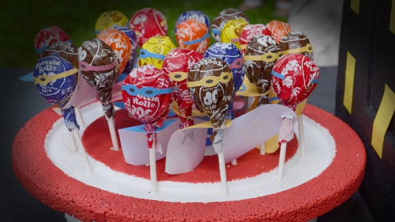 Superhero lollipops in a Captain America shield foam stand.