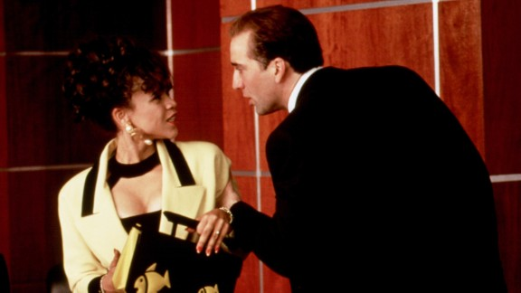 """Rosie Perez and Nicolas Cage played a feuding married couple in """"It Could Happen to You,"""" a part she almost didn't get because director Andy Bergman thought she was too nice for the role. """"He couldn't see me as an annoying bitch,"""" Perez wrote."""