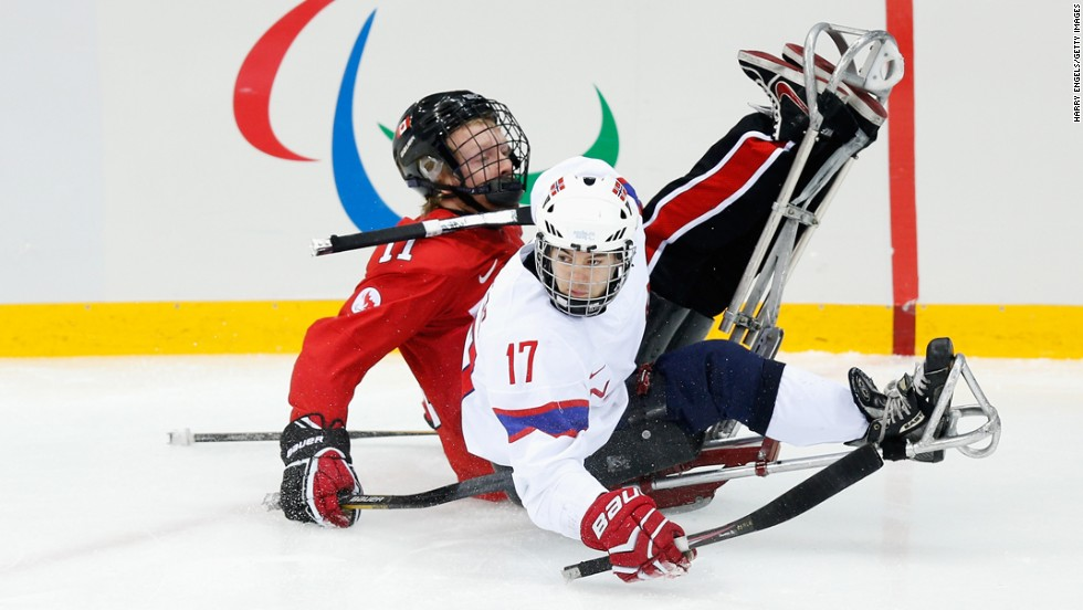 Loyd-Remi Pallander Solberg of Norway, left, collides with Adam Dixon of Canada during the ice sledge hockey bronze medal match at Shayba Arena during the Paralympic Winter Games on Saturday, March 15, in Sochi, Russia.