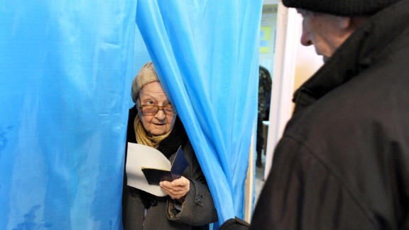 A woman leaves a voting booth in Sevastopol, Ukraine, on Sunday, March 16.  Polls opened Sunday morning in a referendum in Ukraine's Crimea region, in which voters are to voice their wish to either join Russia or become an effectively independent state connected to Ukraine.