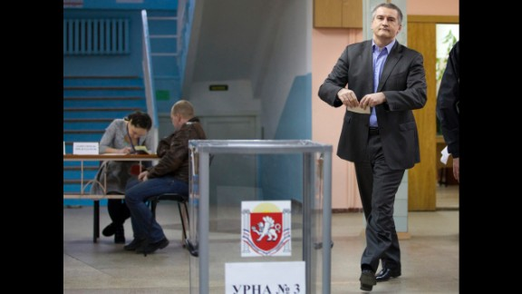 "The newly installed pro-Russian leader of Crimea, Sergey Aksyonov, casts his ballot at a polling station. He called on the residents of Crimea to cast their votes ""independent of nationalism and disintegration."""