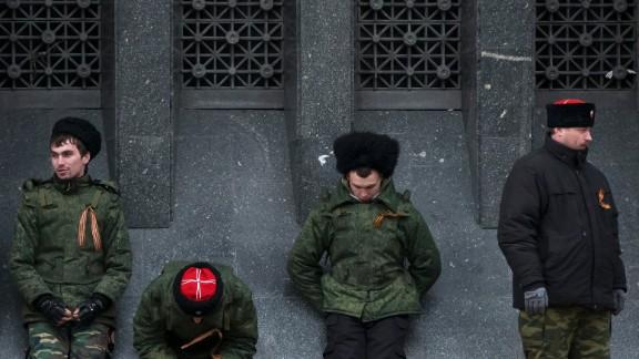 Cossacks guard the regional parliament building during the Crimean referendum in Simferopol.