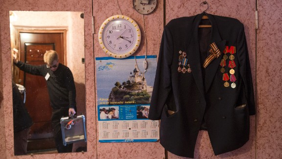 Referendum staff wait to collect the vote of WWII veteran Grinevich Oleksander in Bakhchysaray, Ukraine, on March 16.