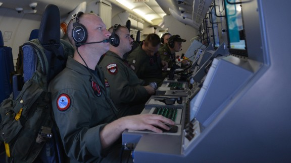 In this photo provided by the U.S. Navy, crew members on board an aircraft P-8A Poseidon assist in search and rescue operations for Malaysia Airlines flight MH370 in the Indian Ocean on Sunday, March 16, 2014. Malaysian authorities on Sunday examined a flight simulator that was confiscated from the home of one of the missing jetliner's pilots. The Boeing 777 went missing less than an hour into a March 8, flight from Kuala Lumpur to Beijing as it entered Vietnamese airspace.