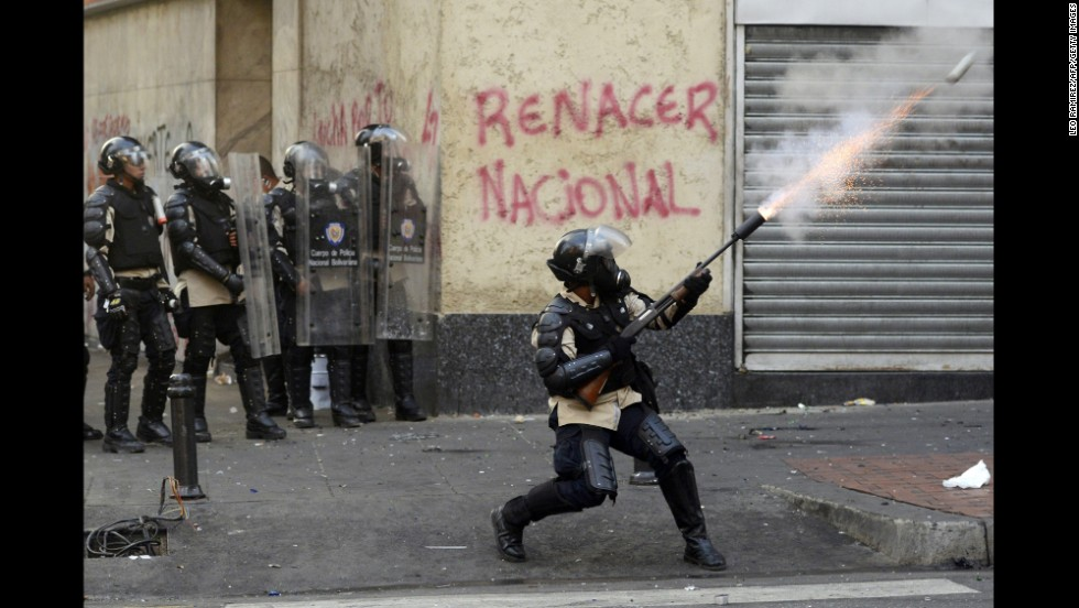 Riot police face off with students in Caracas on March 15.