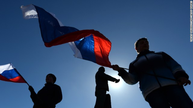 People wave Russian flags in Simferopol's Lenin Square on March 17, 2014. Crimea declared independence on March 17 and applied to join Russia while the Kremlin braced for sanctions after the flashpoint peninsula voted to leave Ukraine in a ballot that will likely fan the worst East-West tensions since the Cold War. Official results from Sunday's poll showed 96.77 percent of the voters in the mostly Russian-speaking region opted to switch to Kremlin rule, in the most radical redrawing of the map of Europe since Kosovo's 2008 declaration of independence from Serbia. AFP PHOTO/ VASILY MAXIMOV        (Photo credit should read VASILY MAXIMOV/AFP/Getty Images)