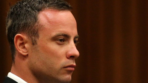 South African Paralympic athlete Oscar Pistorius sits in the dock during his trial for the murder of his girlfriend Reeva Steenkamp, at the North Gauteng High Court in Pretoria, on March 17, 2014. Pistorius is on trial for murdering his girlfriend Reeva Steenkamp at his suburban Pretoria home on Valentine's Day last year. He says he mistook her for an intruder. AFP PHOTO/POOL/Siphiwe Sibeko (Photo credit should read SIPHIWE SIBEKO/AFP/Getty Images)