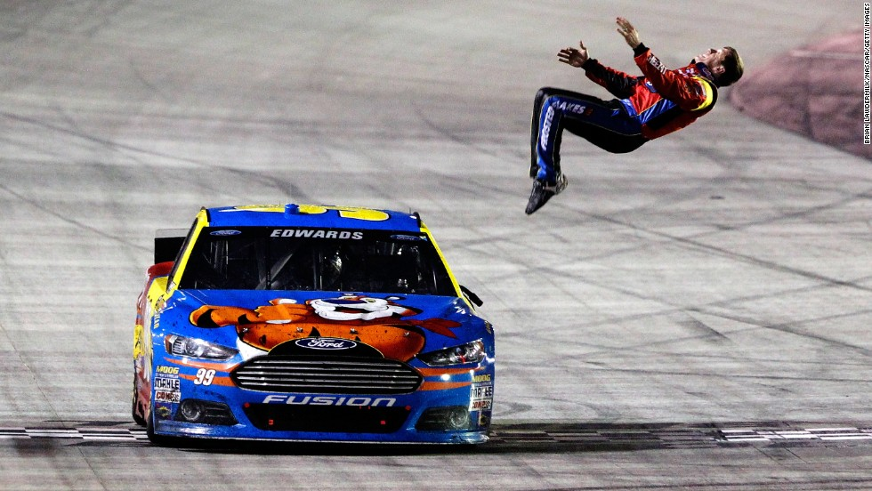 NASCAR driver Carl Edwards celebrates with a back flip after winning the Sprint Cup Series race at Bristol Motor Speedway on Sunday, March 16.
