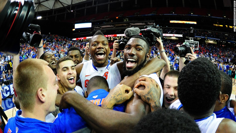 Members of the Florida Gators men's basketball team celebrate Sunday, March 16, after winning the SEC tournament final against Kentucky.