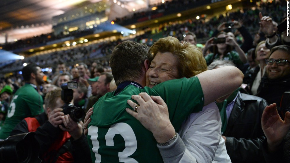 Ireland's Brian O'Driscoll hugs his mother, Geraldine, after his team won the Six Nations rugby match against France on Saturday, March 15, in Paris. The win clinched the championship for Ireland.