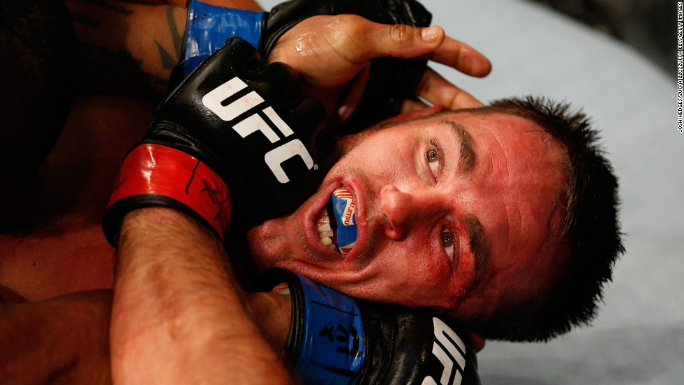 Jake Shields is locked in a hold by Hector Lombard during their welterweight bout at UFC 171, which was held Saturday, March 15, in Dallas.