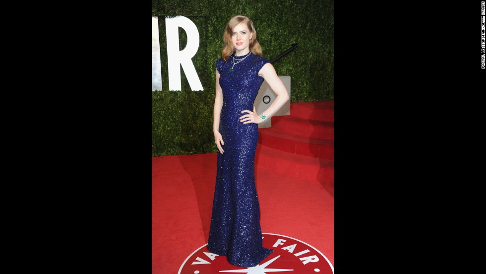 Actress Amy Adams arrives at the 2011 Vanity Fair Oscars party in a blue dress designed by Scott.