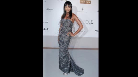 Model Naomi Campbell wears a silver L