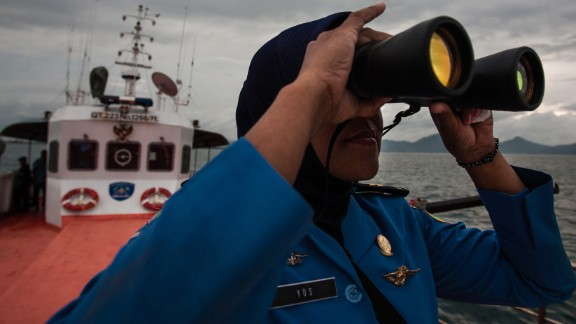 A member of Indonesia's National Search and Rescue looks over the horizon during a search in the Andaman sea area around northern tip of Indonesia's Sumatra island for the missing Malaysia Airlines jet on Monday, March 17.