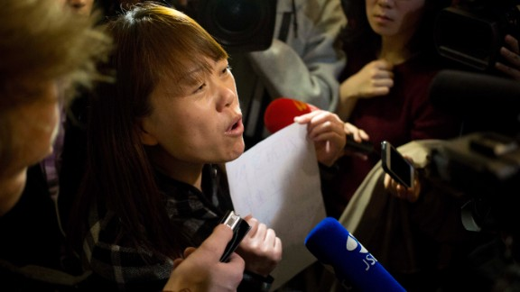 On March 18, 2014, a relative of a missing passenger tells reporters in Beijing about a hunger strike to protest authorities