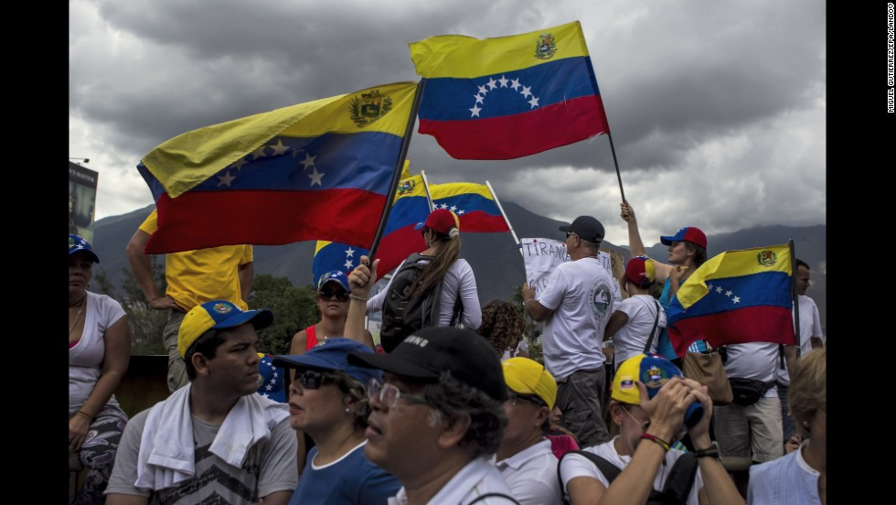 People take part in a protest against President Nicolas Maduro in Caracas on Sunday, March 16.