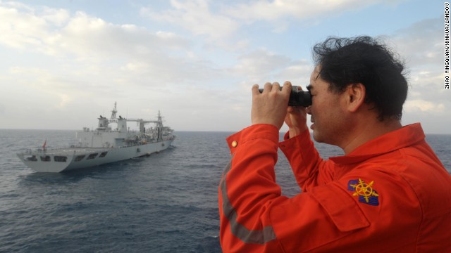 "Image #: 28152349    (140318) -- ABOARD NANHAIJIU 101, March 18, 2014 (Xinhua) -- Vice commander of the Chinese rescue vessel ""Nanhaijiu 101"" Zhang Jianxin watches as the ship approaching Qiandaohu comprehensive supply ship, as both of them head toward Singapore to join in the search for missing Malaysia Airlines flight MH370, March 18, 2014. At 8:00 a.m. on Tuesday, China's Ministry of Transportation ordered all Chinese vessels in the Gulf of Thailand to leave for searches in the waters southeast of the Bay of Bengal and near the Sunda Strait.   (Xinhua/Zhao Yingquan/XINHUA/LANDOV"