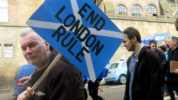 A man carries a placard during a pro-independence march in Edinburgh, Scotland for the upcoming vote on Scotland