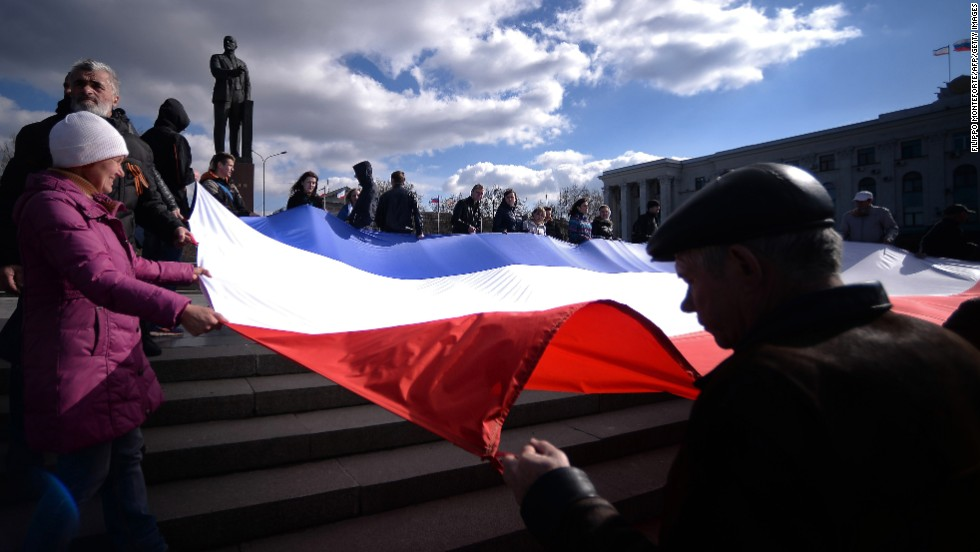 Demonstrators hold a Crimean flag at Lenin Square in Simferopol on March 18.