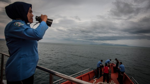 A personnel of Indonesia's National Search and Rescue looks over horizon during a search in the Andaman sea area around northern tip of Indonesia's Sumatra island for the missing Malaysian Airlines flight MH370 on March 17, 2014.