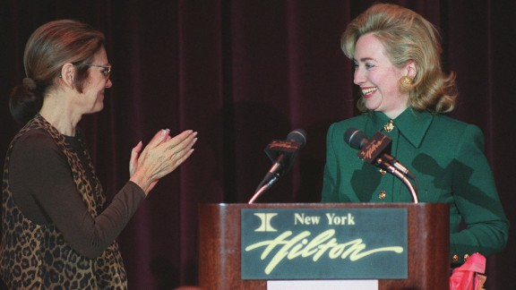 Steinem applauds first lady Hillary Clinton at Clinton's address to the New York Women's Agenda in 1995.