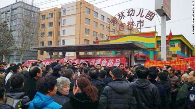 Chinese parents gather in front of the Fanglin Kindergarten in Jilin city, over the school's feeding of a prescription drug to their children on March 17.