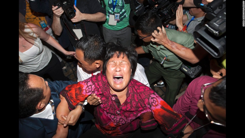 A distraught relative of a missing passenger breaks down while talking to reporters at Kuala Lumpur International Airport on March 19, 2014.