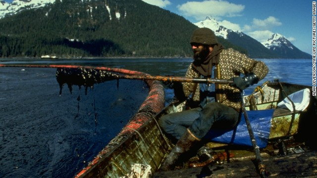 A cleanup worker checks gunk trapped in Prince William Sound after the Exxon Valdez oil spill.
